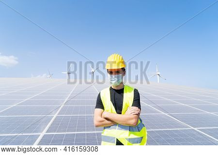 Alternative Energy - Engineer On Solar Panels Plant, Wearing Protective Mask During Pandemia Of Coro