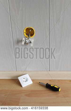 Wall With Built-in Box With Wires To Install Socket And Screwdriver On The Floor. Repair And Install