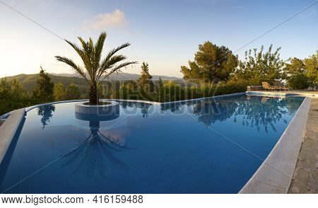 Ibiza, Spain, June 12: Beautiful Swimming Pool And Palm Tree In The Center, Scenic Landscape In Ibiz