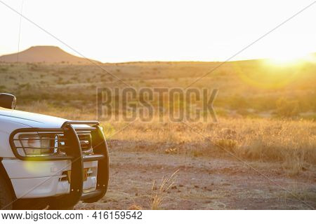 Brandberg, Namibia, Dec 16: Front View Of 4x4 Toyota With The Brandberg Mountain And Sunlight From S