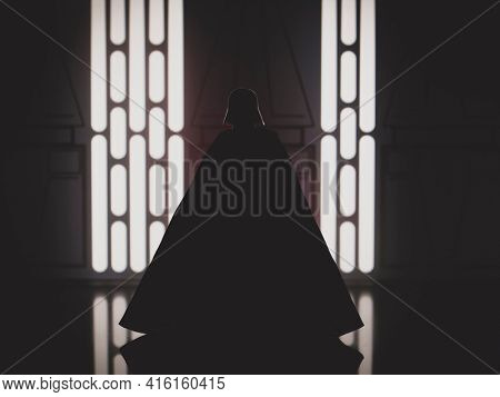 APRIL 8 2021: Silhouette of Star Wars Sith Lord Darth Vader with red lightsaber -  Hasbro action figure