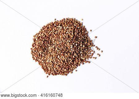 Buckwheat grain on white background. Food ingredient.Top view.