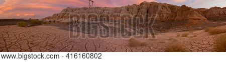 Panorama Of Pink And Red Colored Sunset With Geological Rock Formation At Rodeo With Cracks On The P