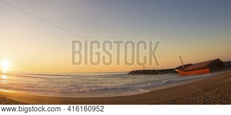 Anglet, France, March 9: Panorama Of The Atlantic Ocean And The  Sunset With Shipwreck On The Beach