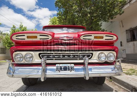 Salta, Argentina, December19: Vintage Red Chevrolet In The Street Of Salta With A Clear Blue Sky, Ar