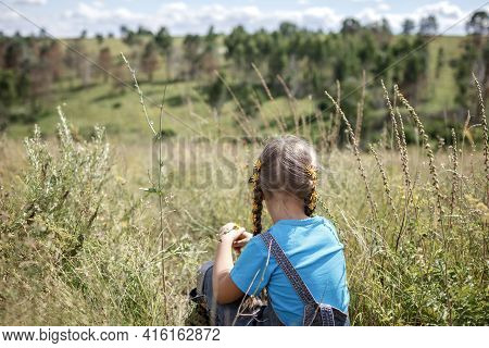 Happy Girl With Yellow Dandelions In Her Hair Relaxing Away On Nature, Digital Detox, Escape And Get
