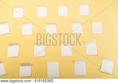 Lots Of Stickers Pasted. Stickers For Notes. Stickers On A Yellow Background. Yellow Stickers On A Y