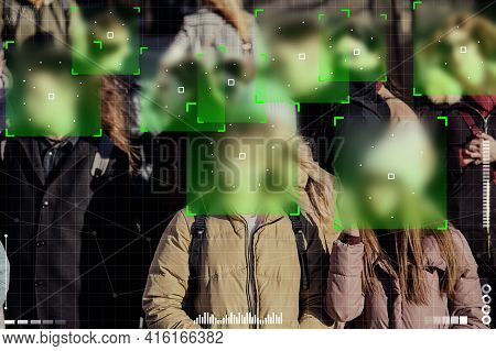 Concept Of Surveillance Camera On The Street For People And Scanning Their Faces.