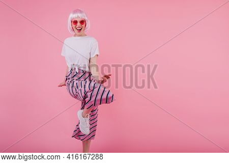 Laughing Stunning Woman In Sunglasses Dancing On Pink Background. Studio Shot Of Cheerful European F