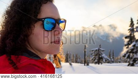 Adventurous White Caucasian Woman Hiking Outdoors In Snow On Top Of Mountain. Sunny Spring Sumset Sk