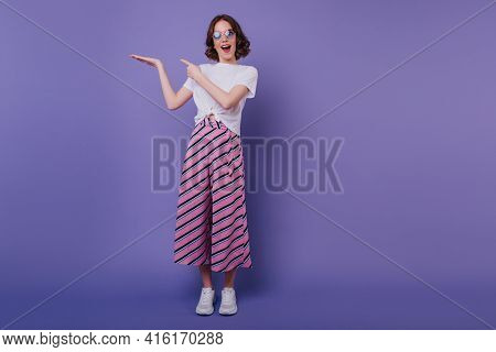 Full-length Portrait Of Spectacular Pretty Woman In Pink Striped Pants. Indoor Shot Of Amazing Good-