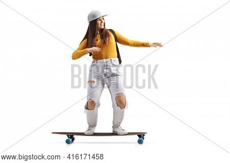 Full length shot of a cool female skater riding a longboard isolated on white background