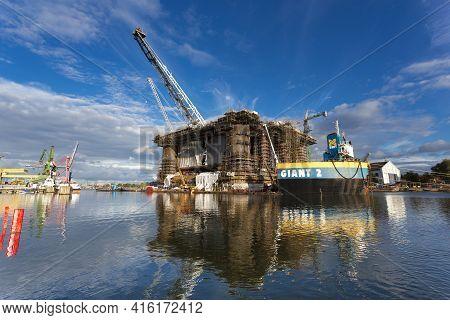 Gdansk, Poland - 19/09/2013: Docking Oil Rig At The Gdansk Shipyard Under Construction In Gdansk, Po