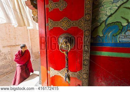 Shigatse, China, April 18: Close Up Of Antique Wooden Colored Door Inside A Tibetan Temple At Shigat