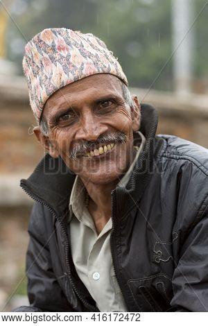 Kathmandu, Nepal, April 22: Nepalese Portrait Senior Man Smiling To The Camera And Wearing A Nepales