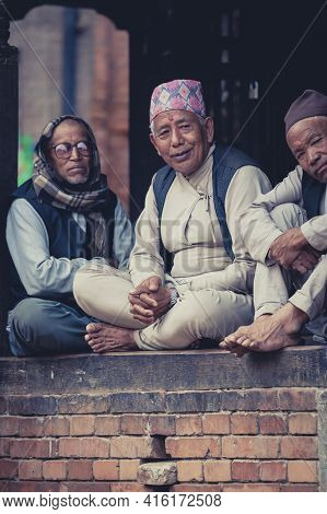 Bhaktapur, Nepal, April 23: Unidentified  Group Of Men Wearing The Traditioinal Nepalese Dress In Th