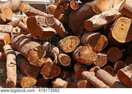 Pile Of Wood Logs Stacked Together On Top Of Each Other. Stack Of Firewood Close Up