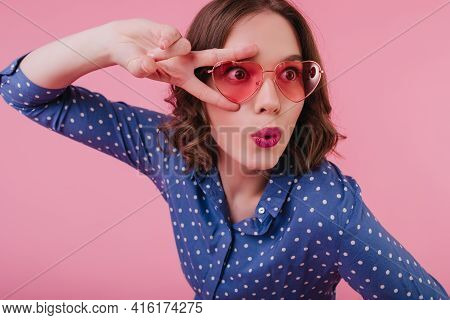 Surprised Female Model In Heart Glasses Posing With Kissing Face Expression. Good-humoured Dark-hair