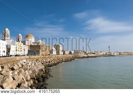 Sunny Day With A Deep Blue Sky In Cadiz, Seafront And The Cathedral Campo Del Sur. Andalusia Region,