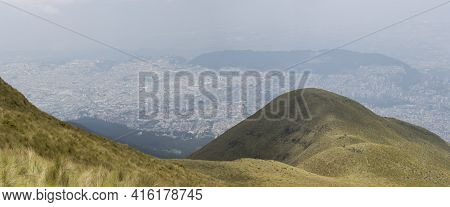 Spectacular Panoramic View Of Quito From The Mountain, The Capital Of Ecuador In The Background.