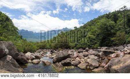 Panorama Of The River, The Rocks, And The Mountains Around Taken From The Angel Falls, Canaima Natio