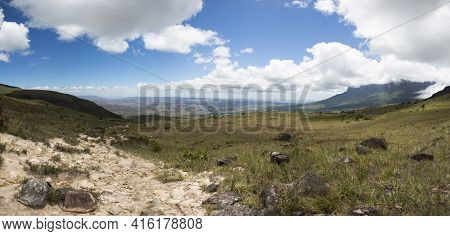 Panorama Of Landscape From Gran Sabana. White Clouds In Blue Sky Over Table-top Mountains Called Tep