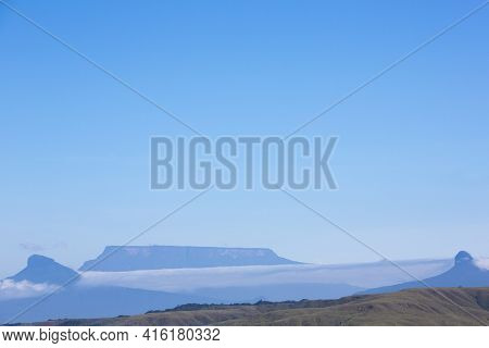 White Clouds In Blue Sky Over Table-top Mountains Called Tepui In Gran Sabana, Guayana Highlands, Ve