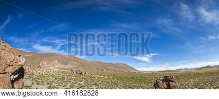 Geological Rock Formations With Strange Shapes Against A Clear Blue Sky In Eduardo Avaroa Andean Fau