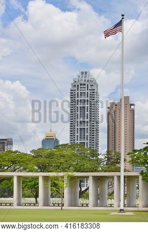 MANILA, PHILIPPINES - APRIL 1, 2016: Manila American Cemetery and Memorial and city skyline. With 17,206 graves it is the largest WWII cemetery for US personnel.
