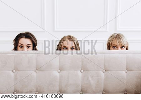 Photo Of Three Young Women Peeping. A Scary Photo Of Three Different Girlfriends. Half Of The Face I