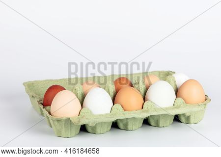 Open Egg Box With Organic, Free Range Chicken Eggs In Different Colors. White, Brown And Dark Brown