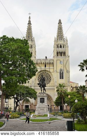 GUAYAQUIL, ECUADOR - FEBRUARY 15, 2017: Seminario Park and Metropolitan Cathedral. Seminario Park is also known as the Iguana Park, since dozens of iguanas live in its ornate gardens.