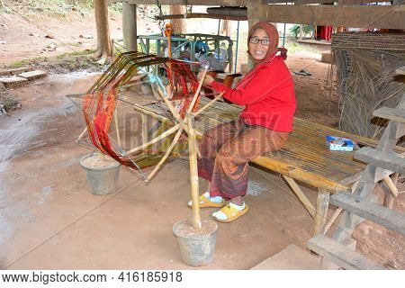 CHIANG RAI, THAILAND - JANUARY 8, 2017: Thai Weaver at the Anantara Golden Triangle Elephant Camp, a charity designed to help elephants and their handlers and families.