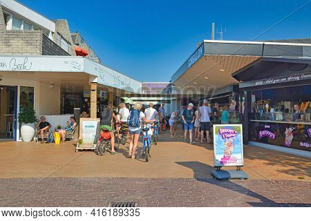 De Koog, Texel  Netherlands - August 2019: Tourists Buying Ice Cream At Ice Parlor On Sunny Summer D
