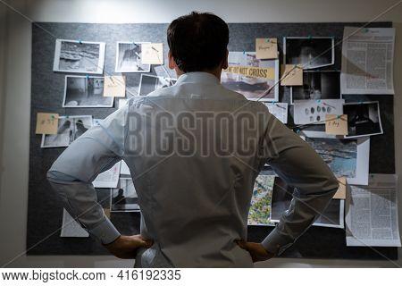 Policeman Or Private Detective Searching Crime Investigation Board