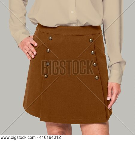 Woman wearing brown skirt close-up