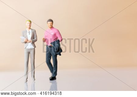 Miniature Business People Standing And Copy Space For Text