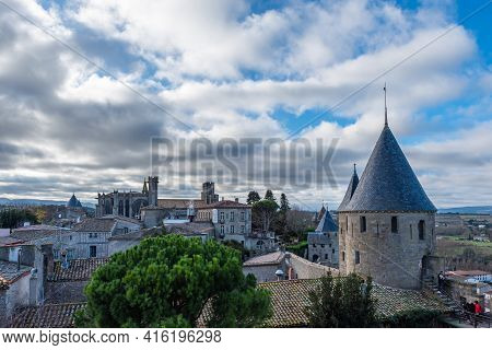 Carcassone, France - December 28, 2019: View To The Basilika Over The Historical Castle Carcassone-