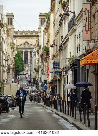 Paris, France - May 6th 2019: View Along The Lively Rue Dhauteville
