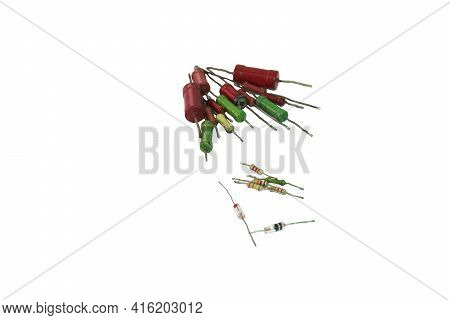 Resistors With Color Code Of Multicolored Stripes And Green Resistor Are Surrounded By Bunch Of Old