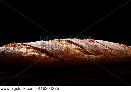Beautiful Bread Close-up. Baguette Side View. Art Bread.