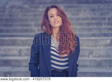 Outdoors Close Up Portrait Of Young Attractive Woman With Curly Red Hair And Sensual Smile. Female M