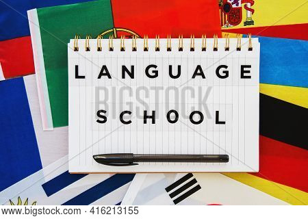 Copybook With The Inscription Language School On The Background Of The National Flags Of Different C