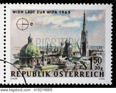 ZAGREB, CROATIA - SEPTEMBER 09, 2014: Stamp printed in Austria, is dedicated to the Vienna International Philatelic Exhibition, shows St. Peter's Church and St. Stephen's Cathedral, Vienna, circa 1964