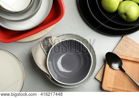 Set Of Clean Dishware And Apples On Grey Table, Flat Lay