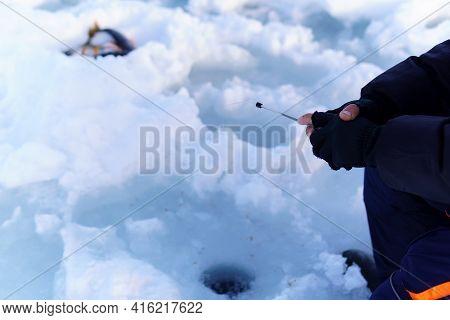 Ice Fishing. Fisherman Fishing On Frozen Lake. Winter Frosty Morning Fishing On River. Selective Foc