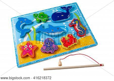 We Catch Marine Life With A Magnetic Rod. The Material Is Wood. Educational Toy Montessori. White Ba