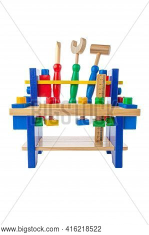 Workbench With Tools. The Material Is Wood. Educational Toy Montessori. White Background. Close-up.