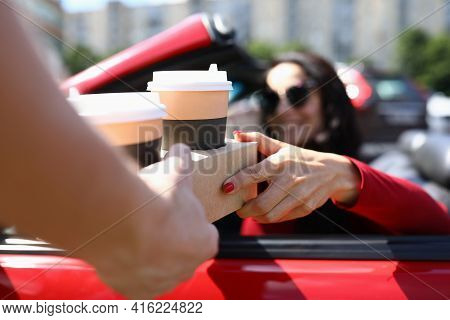 Waiter Serving Coffee To Woman In Car Closeup