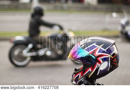 Bright Motorcycle Helmet In Focus And Out Of Focus Motorcycle With Motorcyclist